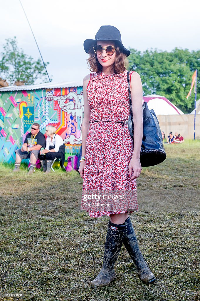 Adelisa , 21,an illustrator from Lyon, France attends the Glastonbury Festival on day 2 wearing a vintage dress and Hunter wellies at Worthy Farm on June 28, 2014 in Glastonbury, England.