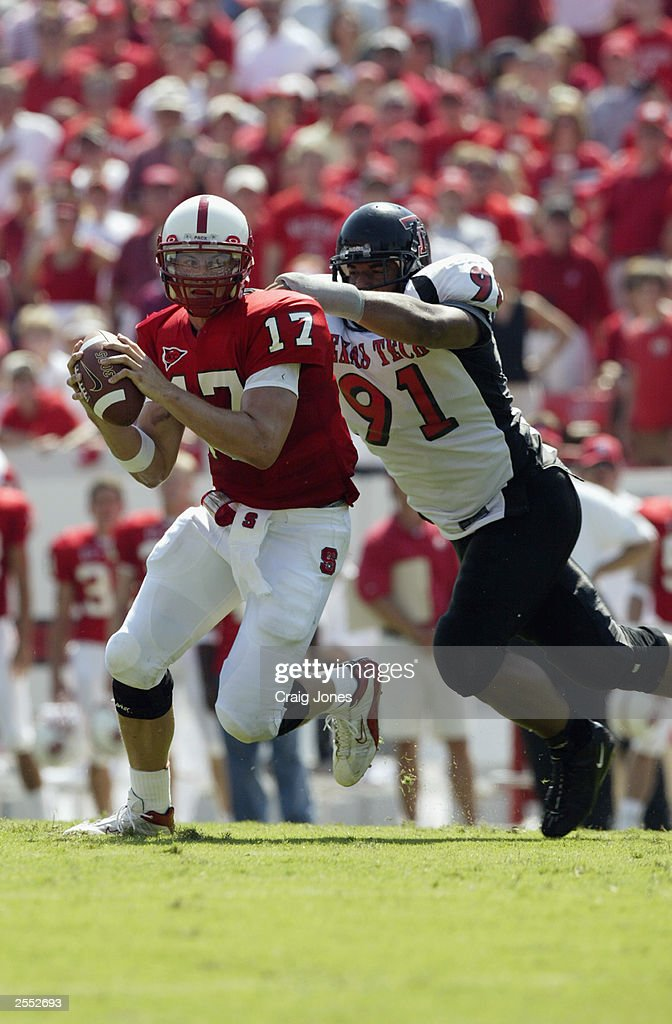 Adell Duckett of the Texas Tech Red Raiders tries to sack Philip Rivers of the North Carolina State Wolfpack on September 20 2003 at Carter Finley...