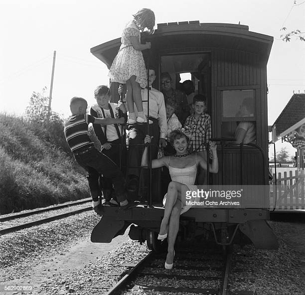 Adelle August pose with kids on the train during the Opening day of Disneyland in AnaheimCalifornia