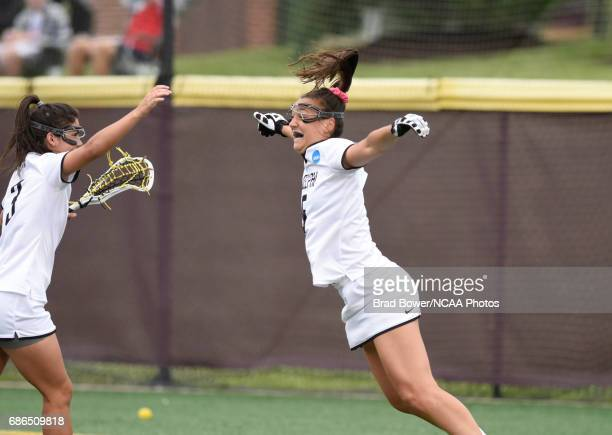 Adelphia University's Casey Zalewski celebrates teammate Jacqueline Jahelka's second half goal against Florida Southern College in the Division II...