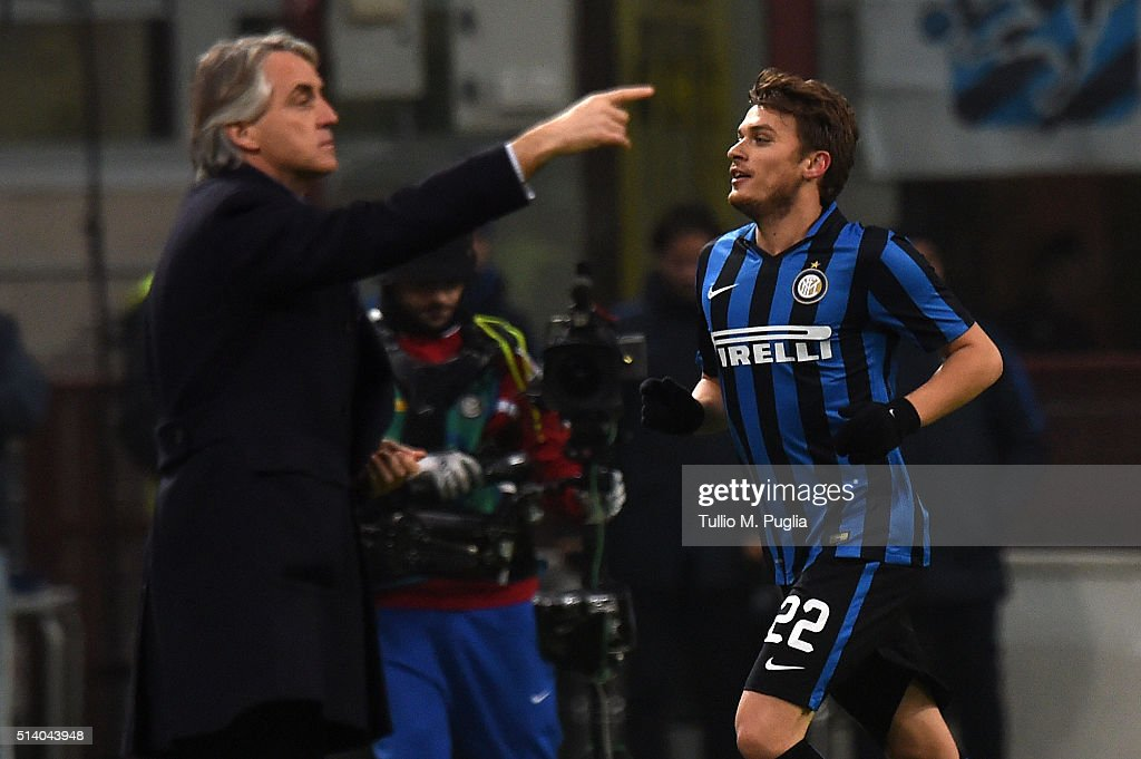 Adem Ljaijc (R) of Inter celebrates after scoring the opening goal as <a gi-track='captionPersonalityLinkClicked' href=/galleries/search?phrase=Roberto+Mancini&family=editorial&specificpeople=234429 ng-click='$event.stopPropagation()'>Roberto Mancini</a> of Inter issues instructionsduring the Serie A match between FC Internazionale Milano and US Citta di Palermo at Stadio Giuseppe Meazza on March 6, 2016 in Milan, Italy.