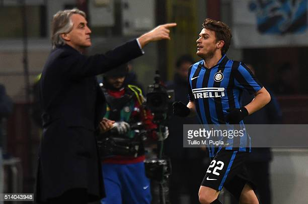 Adem Ljaijc of Inter celebrates after scoring the opening goal as Roberto Mancini of Inter issues instructionsduring the Serie A match between FC...