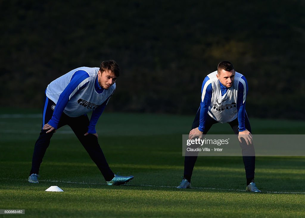 Adem Ljajic and Marcelo Brozovic (R) look on during the FC Internazionale training session at the club's training ground at Appiano Gentile on at Appiano Gentile on December 09, 2015 in Como, Italy.