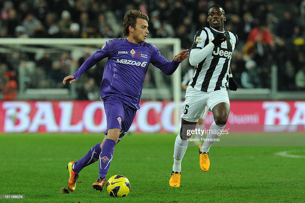 Adem Ljajic (L) of ACF Fiorentina in action against Paul Pogba of Juventus FC during the Serie A match between Juventus FC and ACF Fiorentina at Juventus Arena on February 9, 2013 in Turin, Italy.