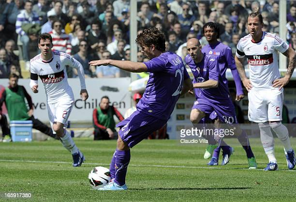 Adem Ljajic of ACF Fiorentina scores his team's first goal from a penalty during the Serie A match between ACF Fiorentina and AC Milan at Stadio...