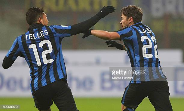 Adem Ljajic of FC Internazionale Milano celebrates with his teammate Alex Telles after scoring the opening goal during the Serie A match between FC...