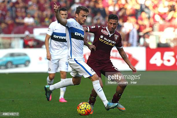 Adem Ljajic of FC Internazionale Milano competes for the ball with Giuseppe Vives of Torino FC during the Serie A match between Torino FC and FC...