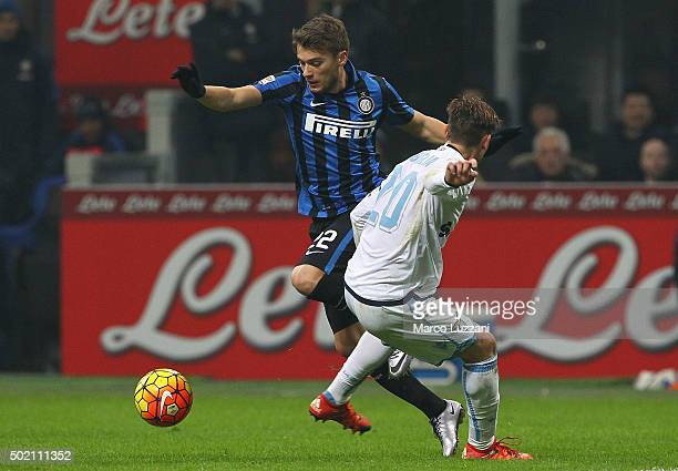 Adem Ljajic of FC Internazionale Milano is challenged by Lucas Biglia of SS Lazio during the Serie A match between FC Internazionale Milano and SS...