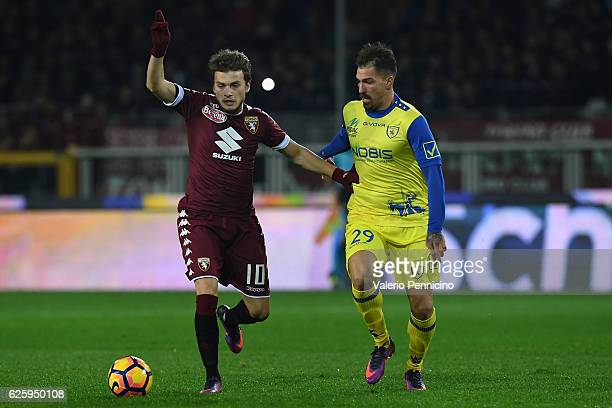 Adem Ljajic of FC Torino competes with Fabrizio Cacciatore of AC ChievoVerona during the Serie A match between FC Torino and AC ChievoVerona at...