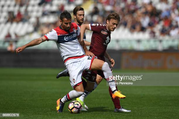 Adem Ljajic of FC Torino is challenged by Gian Marco Ferrari of FC Crotone during the Serie A match between FC Torino and FC Crotone at Stadio...