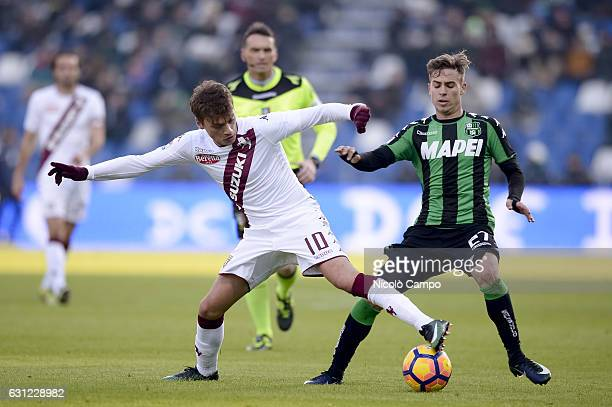 Adem Ljajic of Torino FC and Federico Ricci of US Sassuolo compete for the ball during the Serie A football match between US Sassuolo and Torino FC...