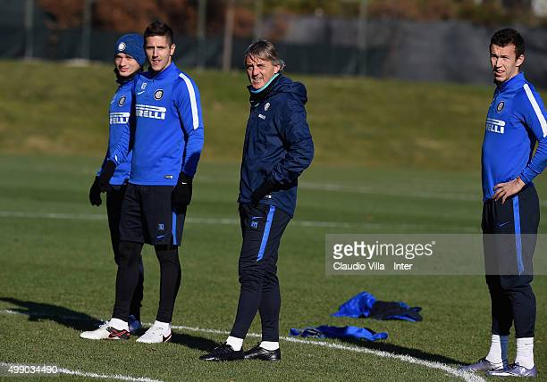 Adem Ljajic Stevan Jovetic head coach Roberto Mancini and Ivan Perisic look on during the FC Internazionale training session at the club's training...