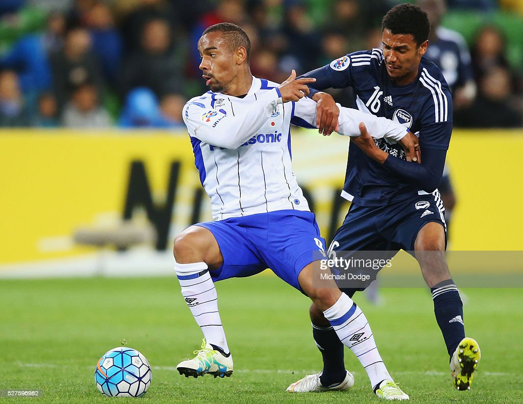 Ademilson of Gamba Osaka (L) and Rashid Mahazi of the Victory compete for the ball during the AFC Champions League match between Melbourne Victory and Gamba Osaka at AAMI Park on May 3, 2016 in Melbourne, Australia.