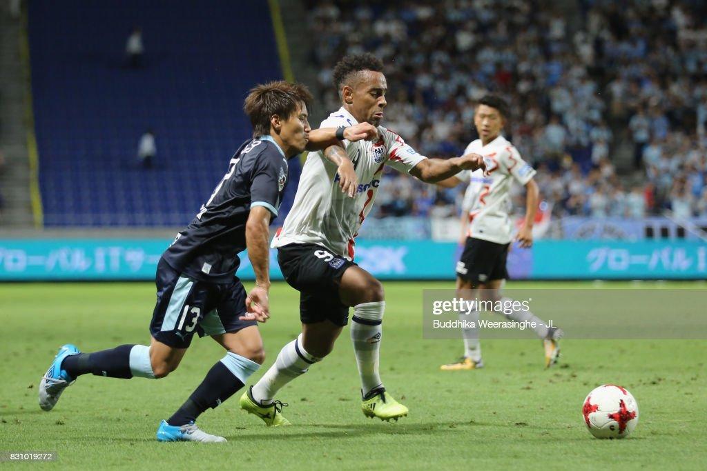Ademilson of Gamba Osaka and Tomohiko Miyazaki of Jubilo Iwata compete for the ball during the J.League J1 match between Gamba Osaka and Jubilo Iwata at Suita City Football Stadium on August 13, 2017 in Suita, Osaka, Japan.