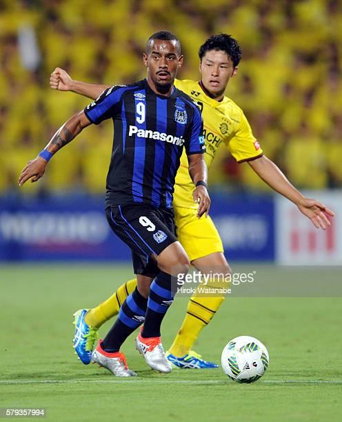Ademilson of Gamba Osaka controls the ball under pressure of Yuta Nakayama of Kashiwa Reysol during the JLeague match between Kashiwa Reysol and...