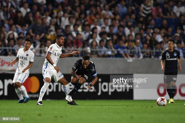 Ademilson of Gamba Osaka is challenged by Pedro Junior of Kashima Antlers during the JLeague J1 match between Gamba Osaka and Kashima Antlers at...