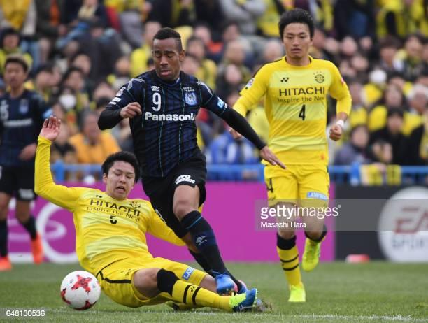 Ademilson of Gamba Osaka is fouled by Yuta Nakayama of Kashiwa Reysol resulting in a penalty kick to Gamba Osaka during the JLeague J1 match between...