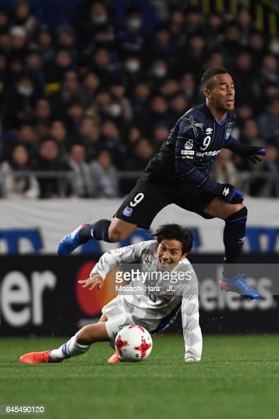 Ademilson of Gamba Osaka is tackled by Shohei Ogura of Ventforet Kofu during the JLeague J1 match between Gamba Osaka and Ventforet Kofu at Suita...