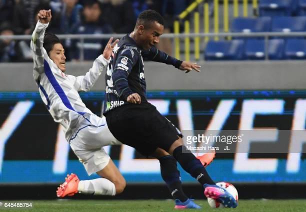 Ademilson of Gamba Osaka shoots at goal while Shohei Ogura of Ventforet Kofu tries to block during the JLeague J1 match between Gamba Osaka and...