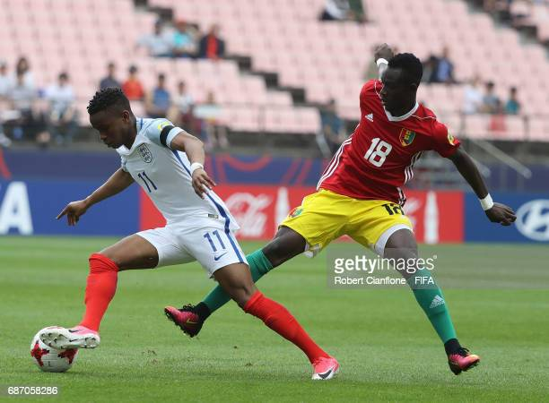 Ademola Lookman of England is challenged by Alseny Soumah of Guinea during the FIFA U20 World Cup Korea Republic 2017 group A match between England...