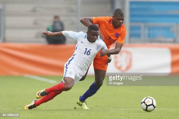 Ademola Lookman of England U21 Denzel Dumfries of Holland U21 during the EURO U21 2017 qualifying match between Netherlands U21 and England U21 at...