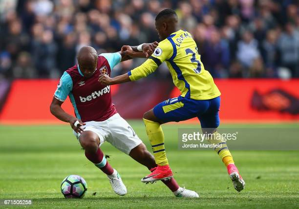 Ademola Lookman of Everton and Andre Ayew of West Ham United in action during the Premier League match between West Ham United and Everton at the...
