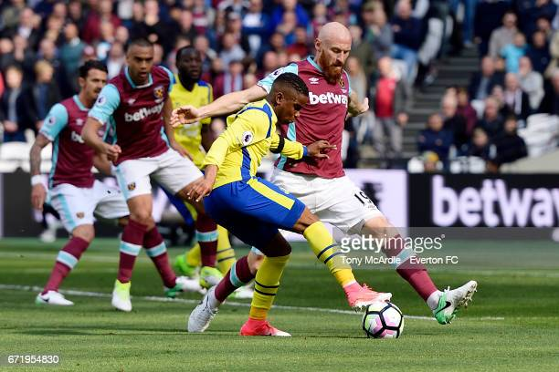 Ademola Lookman of Everton and James Collins of West Ham challenge for the ball during the Premier League match between West Ham United and Everton...
