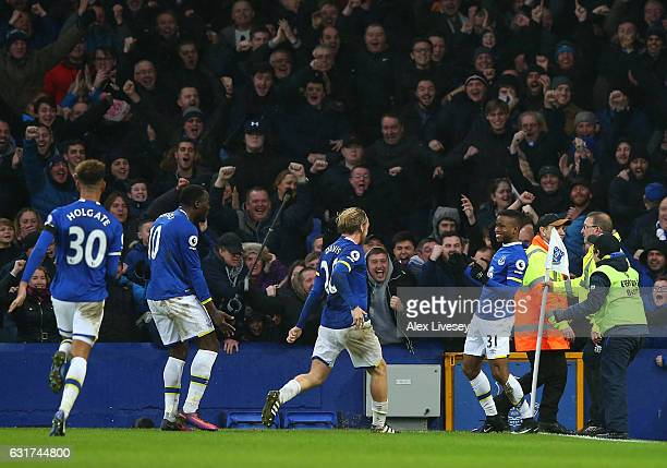 Ademola Lookman of Everton celebrates with teammates after scoring his team's fourth goal during the Premier League match between Everton and...