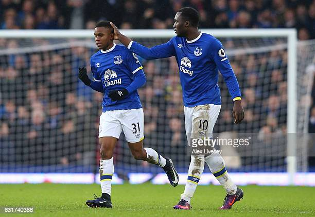 Ademola Lookman of Everton is congratulated by teammate Romelu Lukaku after scoring his team's fourth goal during the Premier League match between...