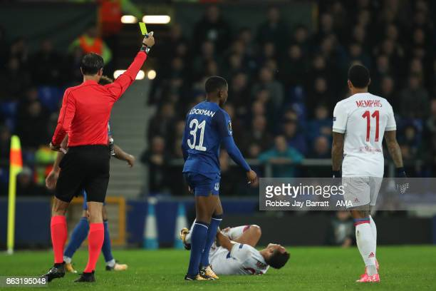 Ademola Lookman of Everton receives a yellow card during the UEFA Europa League group E match between Everton FC and Olympique Lyon at Goodison Park...