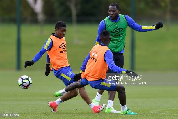 Ademola Lookman Romelu Lukaku and Idrissa Gueye challenge for the ball during the Everton FC training session at USM Finch Farm on April 13 2017 in...