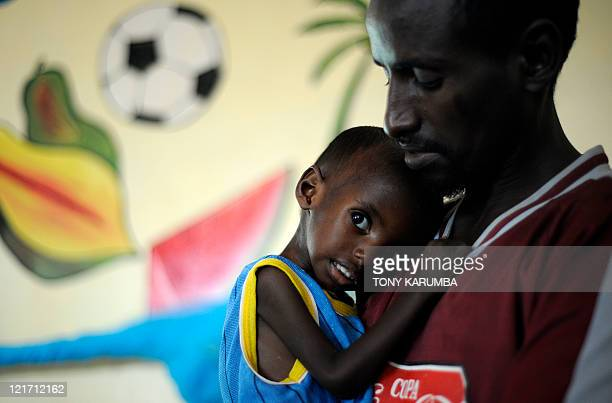 Aden a threeyearold Somali refugee with his father Abdille recovers at the stabilisation centre at Hagadere refugee area on August 2 2011 after...