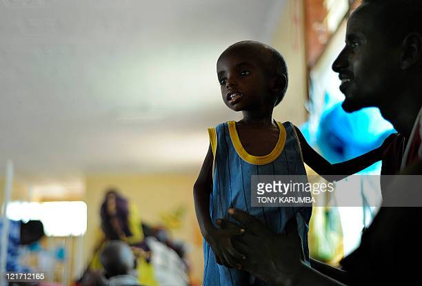 Aden a threeyearold Somali refugee with his father Abdille recovers at the stabilisation centre at Hagadere refugee area August 02 2011 after...