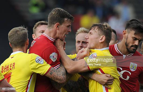Aden Flint of Bristol City and Kyle McFadzean of MK Dons clash during the Sky Bet Championship match between Bristol City and MK Dons at Ashton Gate...