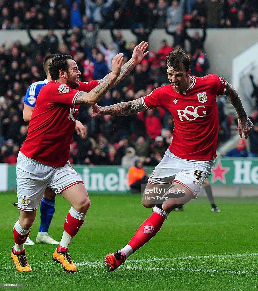 Aden Flint of Bristol City(R) celebrates his side's first goal with <a gi-track='captionPersonalityLinkClicked' href=/galleries/search?phrase=Lee+Tomlin&family=editorial&specificpeople=7126500 ng-click='$event.stopPropagation()'>Lee Tomlin</a> of Bristol City (L) during the Sky Bet Championship match between Bristol City and Ipswich Town at Ashton Gate on February 13, 2016 in Bristol, England.