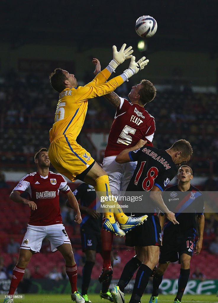 Aden Flint (C) of Bristol City is sandwiched between Neil Alexander (L) and Aaron Wilbraham (R) of Crystal Palace during the Capital One Cup second round match between Bristol City and Crystal Palace at Ashton Gate on August 27, 2013 in Bristol, England.