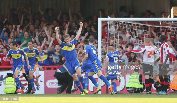 Aden Flint of Swindon Town scores a goal during the npower League One Play Off Semi Final Second Leg match between Brentford and Swindon Town at...
