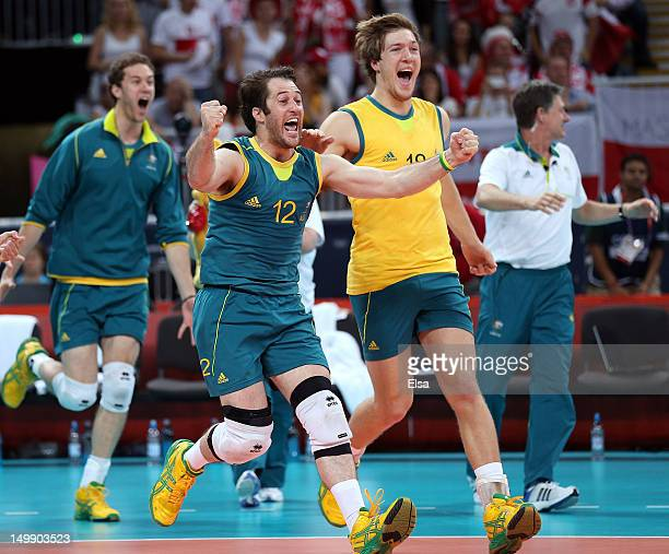 Aden Tutton and the rest of the Australia bench runs out on the court after the match win over Poland during Men's Volleyball on Day 10 of the London...