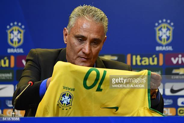 Adenor Leonardo Bacchi known as Tite holds a jersey of the Brazilian national football team during a press conference after being appointment by the...