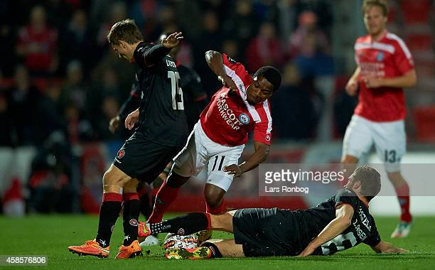 Adeola Runsewe of Silkeborg IF Jesper Lauridsen of FC Midtjylland and Jim Larsen of FC Midtjylland compete for the ball during the Danish Superliga...