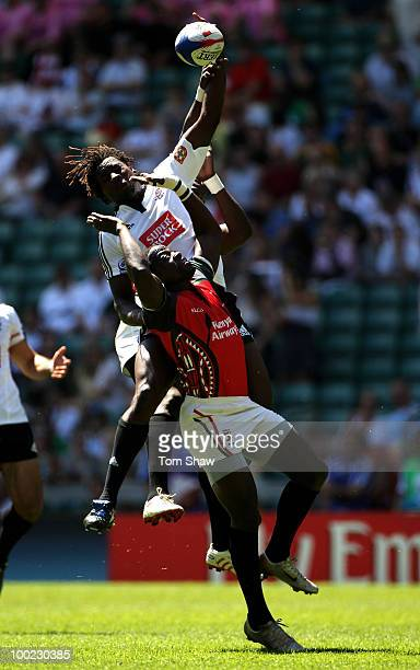 Aderito Esteves of Portugal touches the ball away during the Pool B match between Portugal and Kenya during day one of the IRB London Sevens at...