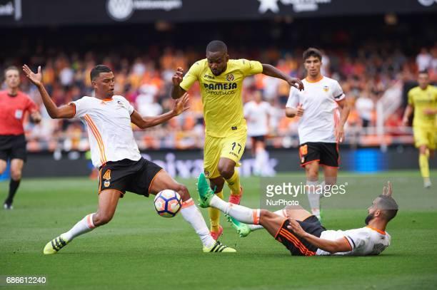Aderlan Santos of Valencia CF and Cedric Bakambu of Villarreal CF during their La Liga match between Valencia CF and Villarreal CF at the Mestalla...
