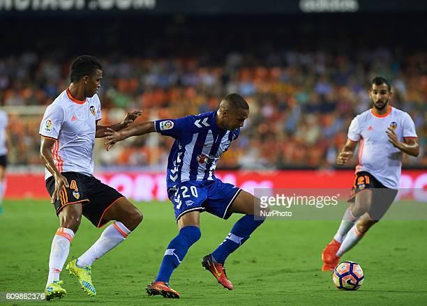 Aderlan Santos of Valencia CF vies Deyverson Silva of Deportivo Alaves during the La Liga match between Valencia CF vs Deportivo Alaves at Mestalla...