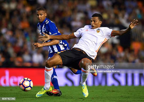 Aderlan Santos of Valencia competes for the ball with Deyverson of Deportivo Alaves during the La Liga match between Valencia CF and Deportivo Alaves...