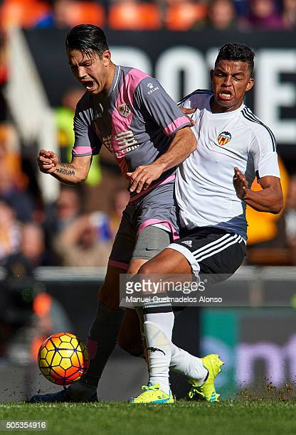Aderlan Santos of Valencia competes for the ball with Miku of Rayo Vallecano during the La Liga match between Valencia CF and Rayo Vallecano at...