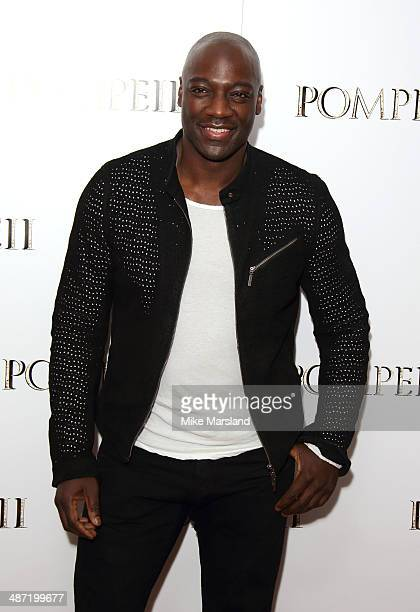 Adewale AkinnuoyeAgbaje attends a VIP screening of 'Pompeii' at Vue West End on April 28 2014 in London England