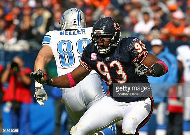 Adewale Ogunleye of the Chicago Bears rushes past Will Heller of the Detroit Lions on October 4 2009 at Soldier Field in Chicago Illinois The Bears...