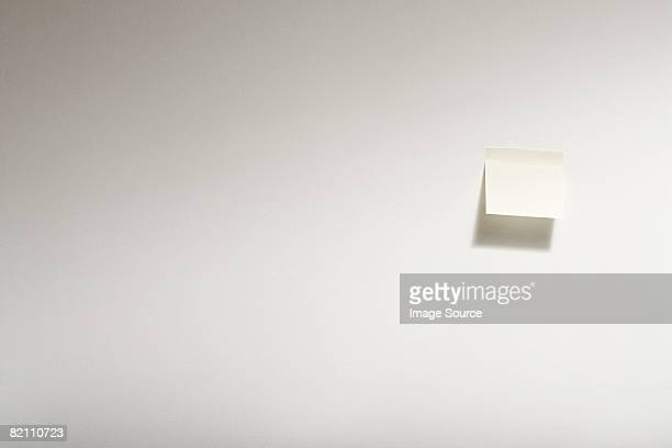 Adhesive note on wall