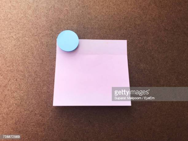 Adhesive Note On Wooden Wall