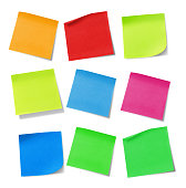 Multicolored adhesive notes on white background